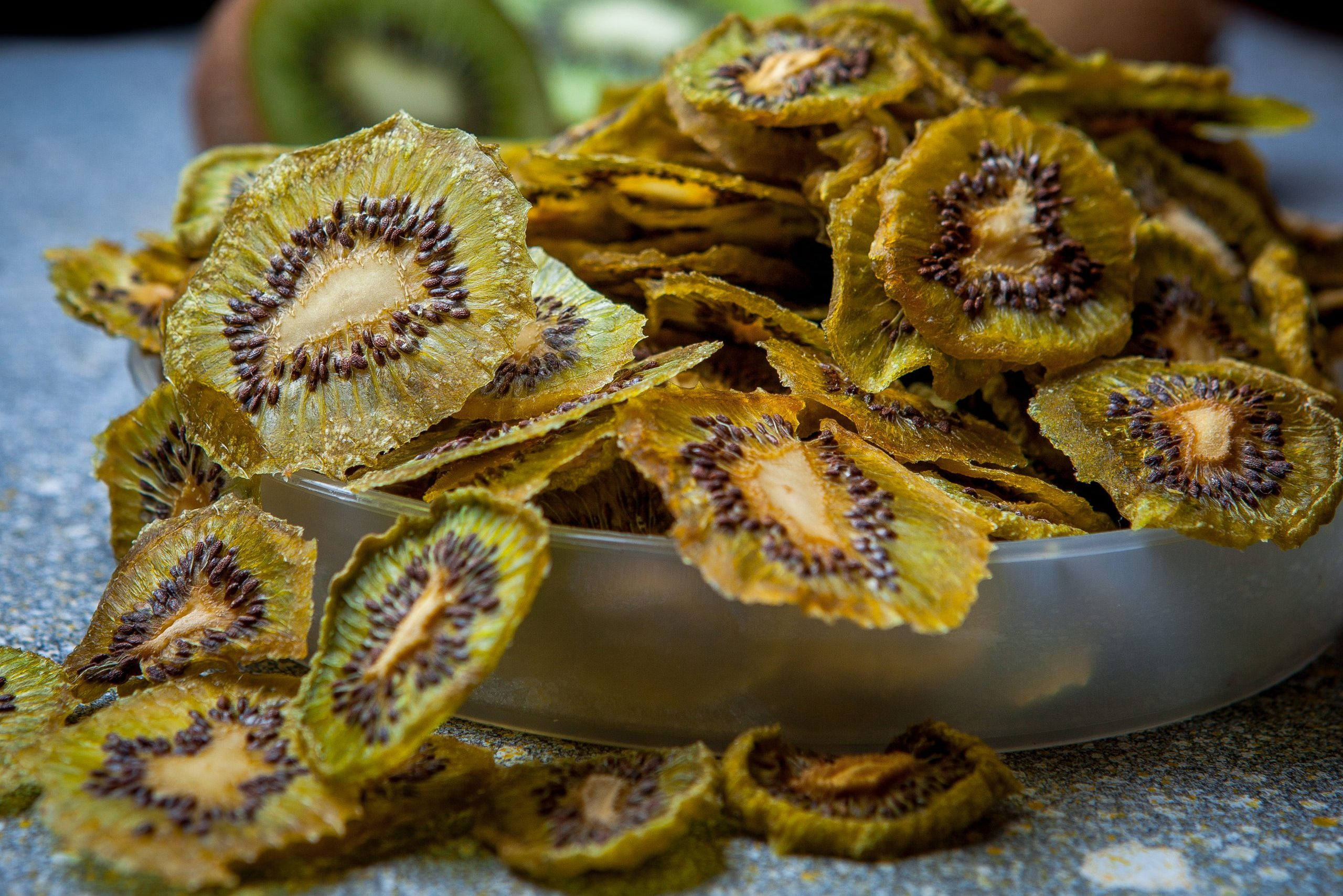 Dried kiwi fruit on stone table horizontal